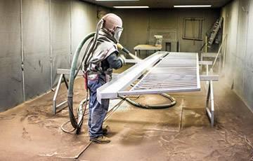 Піскоструменеве очищення металу
